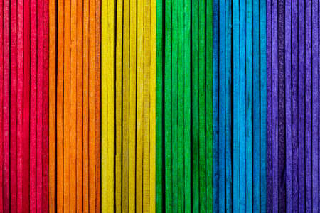 Beautiful texture of natural wood slats. With the colors of the rainbow (violet, purple, blue, green, yellow, orange and red). Vertical sense.