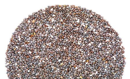 Heap of sermicircular shaped chia seeds. Top view. Macro close-up. With copy space.