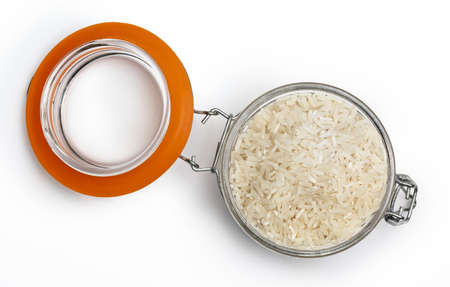 Open jar with raw and dry white rice. Top view. Isolated on white background.