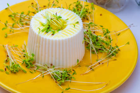 Fresh cheese, tender alfalfa sprouts and virgin olive oil for a healthy and healthy diet. Stock fotó