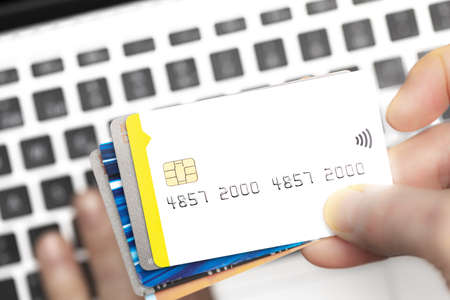 Close-up of online shopper paying with credit cards on computer keyboard with copy space. Online shopping. Stock fotó