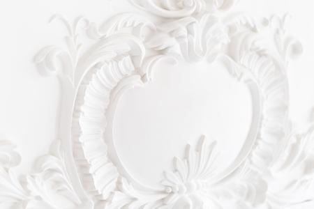 Beautiful ornate white decorative plaster moldings in studio