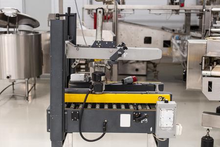 Ice cream production line. Conveyor production. Machine for conveyor line. Selective focus.