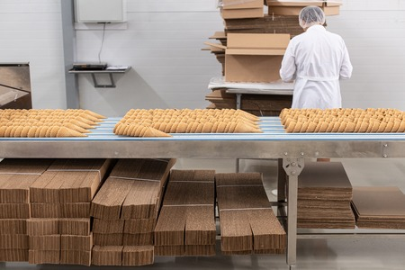 Ice cream production line. Conveyor production. Production of wafer cups for ice cream. Selective focus