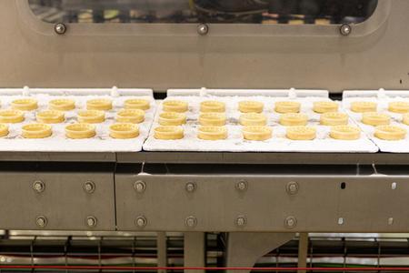 Ice cream production line. Conveyor production. Machine for conveyor line. Selective focus Reklamní fotografie