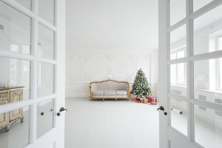 Luxury bright Baroque interior with vintage sofa and Christmas tree.