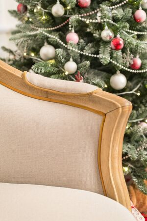 Vintage sofa in the interior with Christmas tree. Close up. Selective focus.