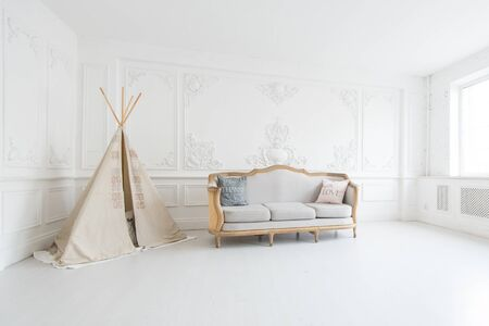 Modern luxury child room interior with bed and play tent.