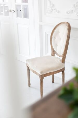 Vintage chair with textile upholstery in a luxurious interior. Soft focus. Reklamní fotografie