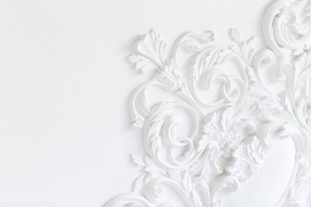 Beautiful ornate white decorative plaster moldings in studio.
