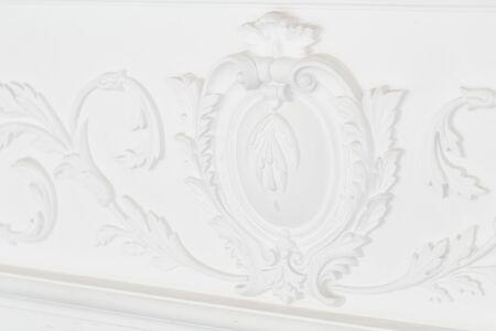 Beautiful ornate white decorative plaster moldings in studio.