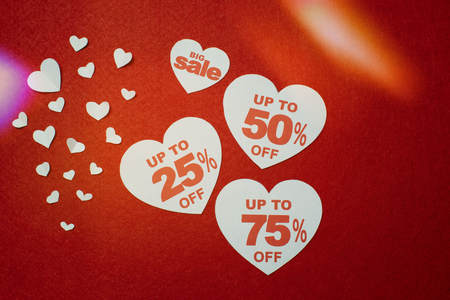 Big sale and discounts written on big white hearts over the red background. Hearts and discount promotion Standard-Bild