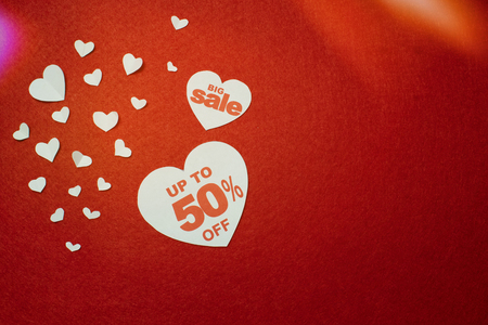 Sale discounts in the heart, minus 50, nice and cute design on the red background with white hearts of different shape