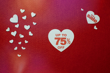 Sale discounts in the heart, minus 75, nice and cute design on the red background with white hearts of different shape