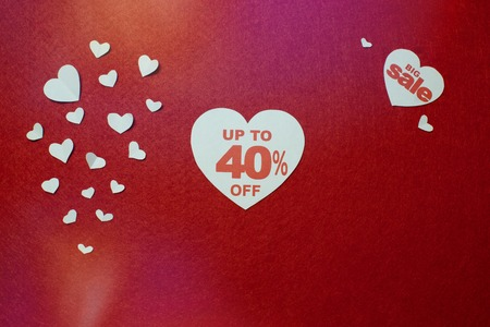 White heart with number forty for big sale on a red background. 40 per cent off for Valentines day