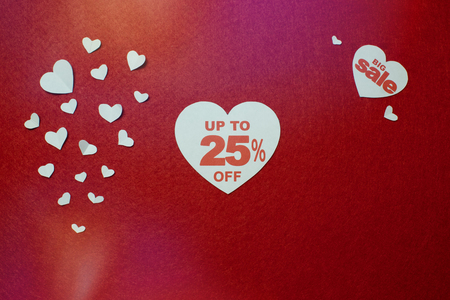 illustration of percentage number discount in heart over the red background. Up to 25 off, big sale, different shaped white hearts