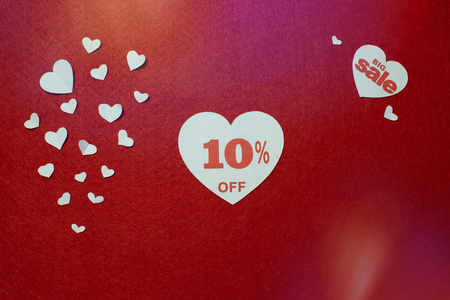 Big sales, ten percent in a white heart on red background for flyer, poster, shopping, sign, discount, marketing, selling, holiday