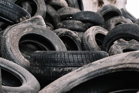 old black tires in a landfill for recycling. Standard-Bild