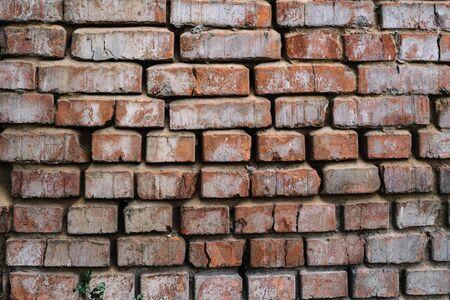 old red brick wall, cracked brickwork texture.