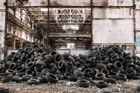 Wall of old car tires in the old factory.