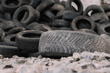 Pile of used tires. old tire on the background of others