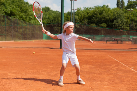 boys: boy practicing tennis Stock Photo