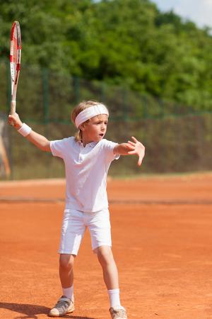 boy practicing tennis Stock Photo