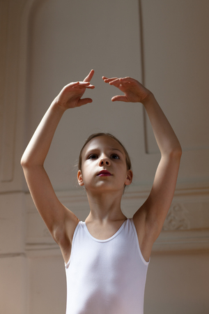 little girl dancing: young ballerina posing Stock Photo