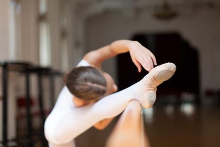 practicing: girl practicing ballet