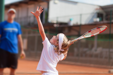 tennis clay: boy practicing tennis Stock Photo