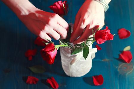 woman arranging flowers Stock Photo