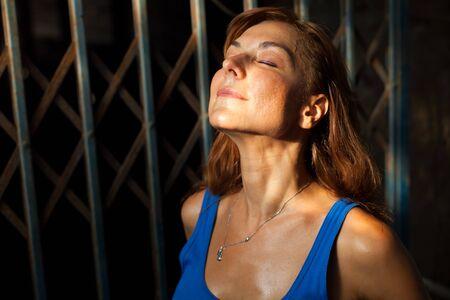 young woman enjoying sunlight Stock Photo