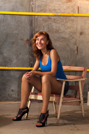 conceived: beautiful woman sitting on a chair