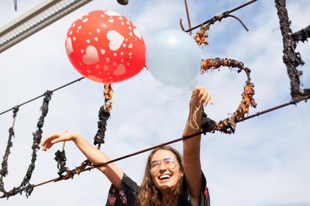 young woman holding balloons having fun Stock Photo