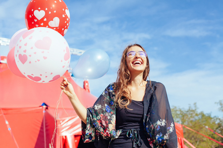 young woman with many balloons