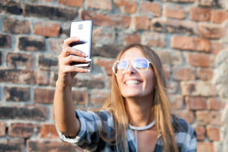 portrait of young woman taking selfie