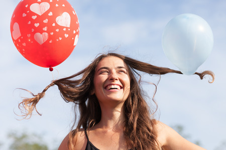 young woman with balloons in her hair