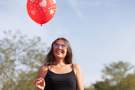 young woman with balloon Stock Photo