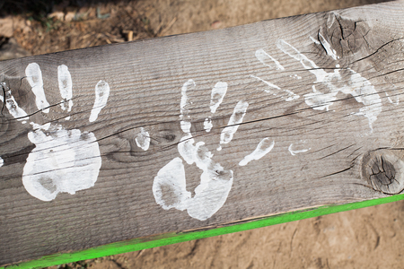 white hands paint prints on wood Stock Photo