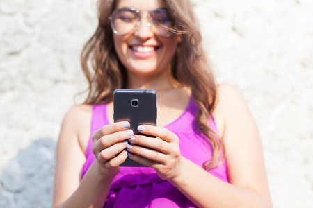 young woman looking at smartphone
