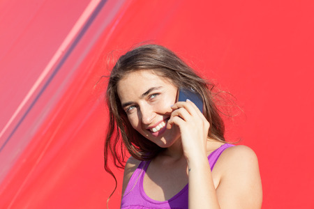 young woman talking on smartphone