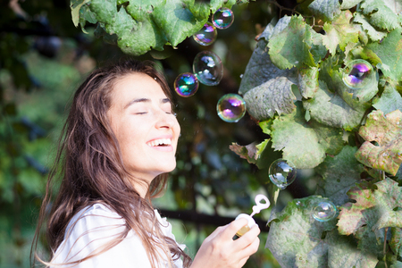 young woman having fun with bubbles