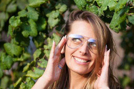 young woman posing with new eyeglasses