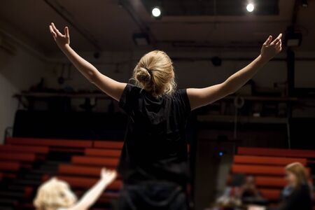 actress rehearsing in front of empty theater Stock fotó