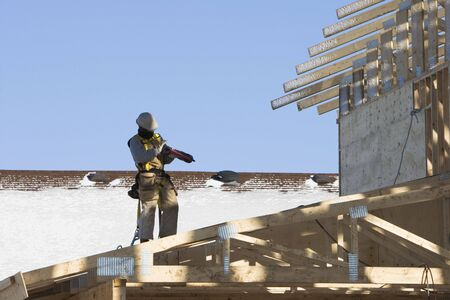 jobsite: Roofer working on a cold Winter day Stock Photo