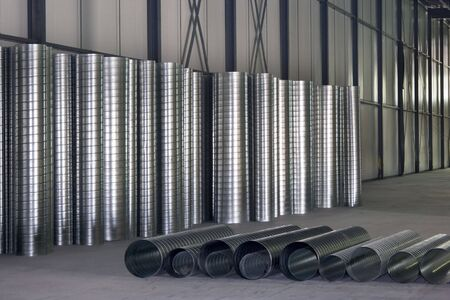 mechanical ventilation: Ventilation pipes ready for installation in a wharehouse  Stock Photo