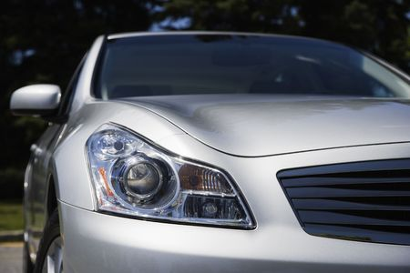 gleaming: Head light and grill on a silver Japinese sports sedan