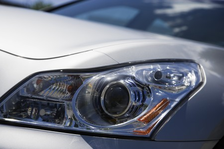 Head lights on a silver Japinese sports sedan