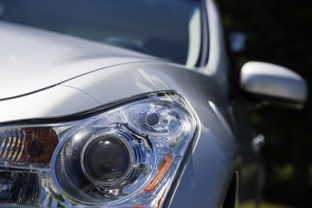 gleaming: Head lights on a silver Japinese sports sedan