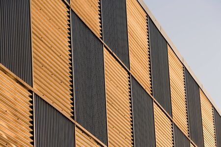 Corrugated metal wall pannels reflecting the sunset photo